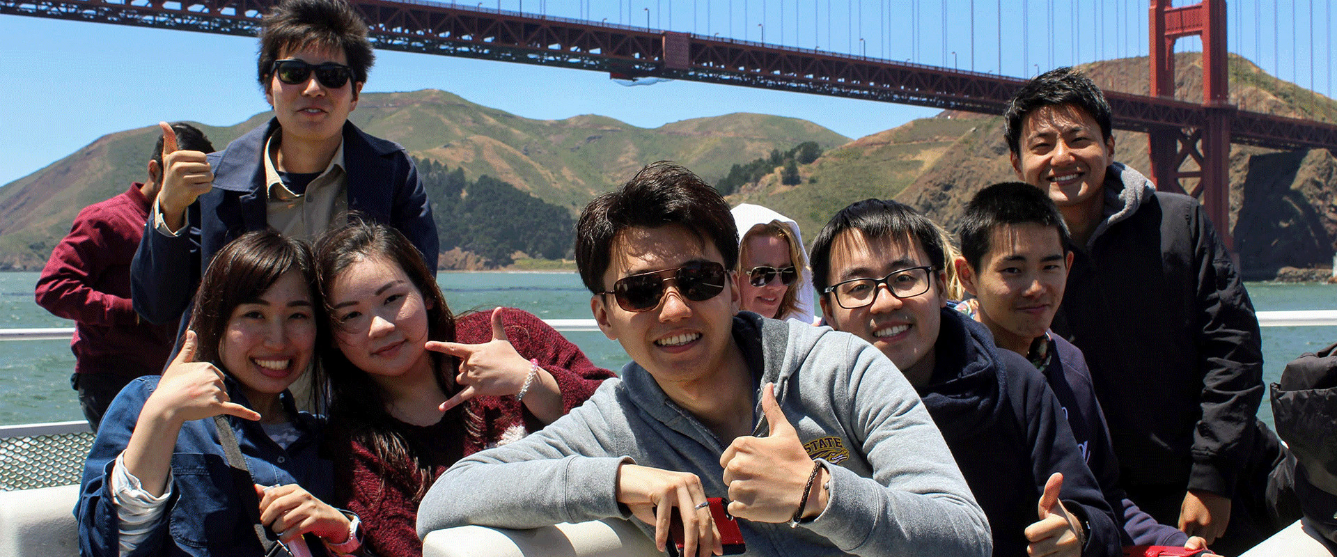 American Language Institute students on a bay cruise near San Francisco's Golden Gate Bridge