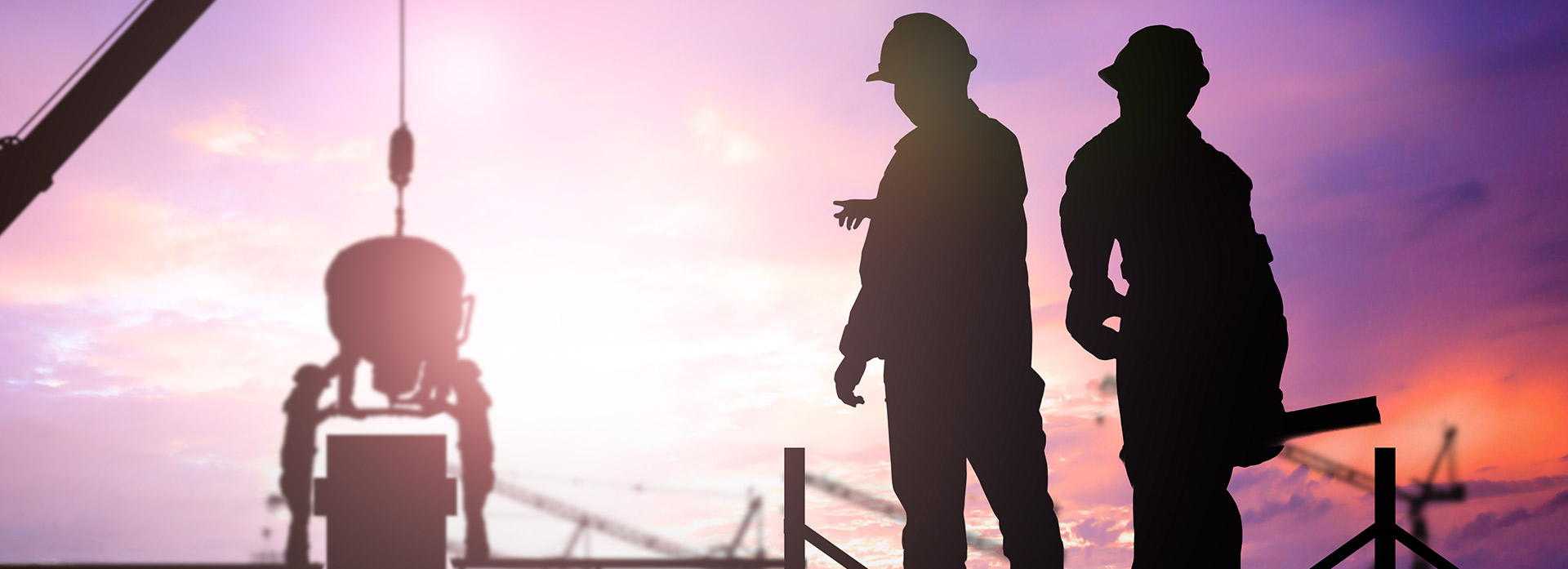 construction workers with a purple sunset background