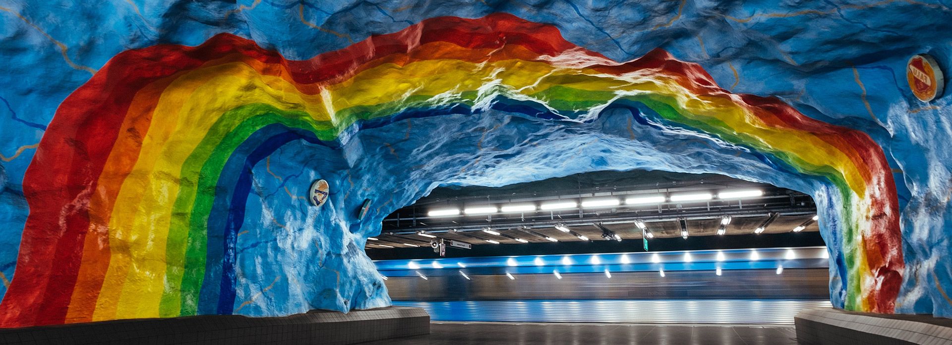 Rainbow painted in a train station cave in Stockholm