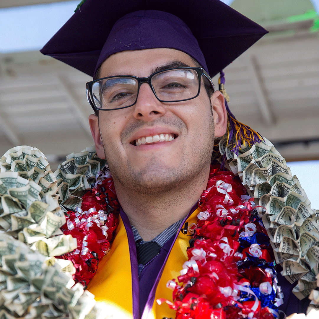 Graduate with a money lei