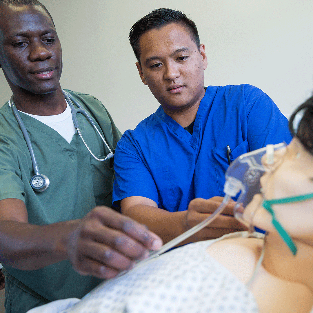 A pair of nursing students practices administering oxygen