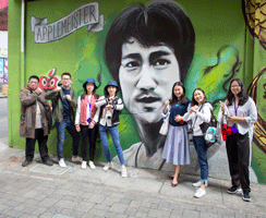 International Students in front of the Bruce Lee Mural