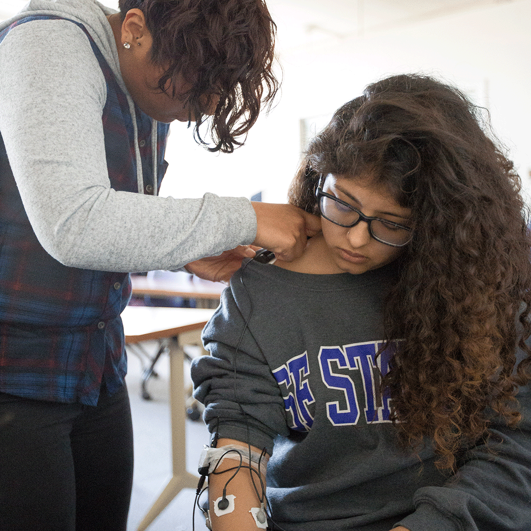 Holistic Health Student having electrodes placed for biofeedback