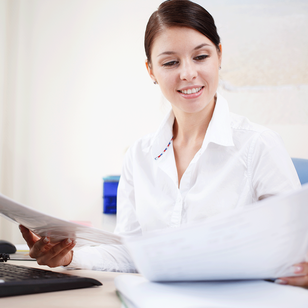 Medical Administrative Assistant with paperwork
