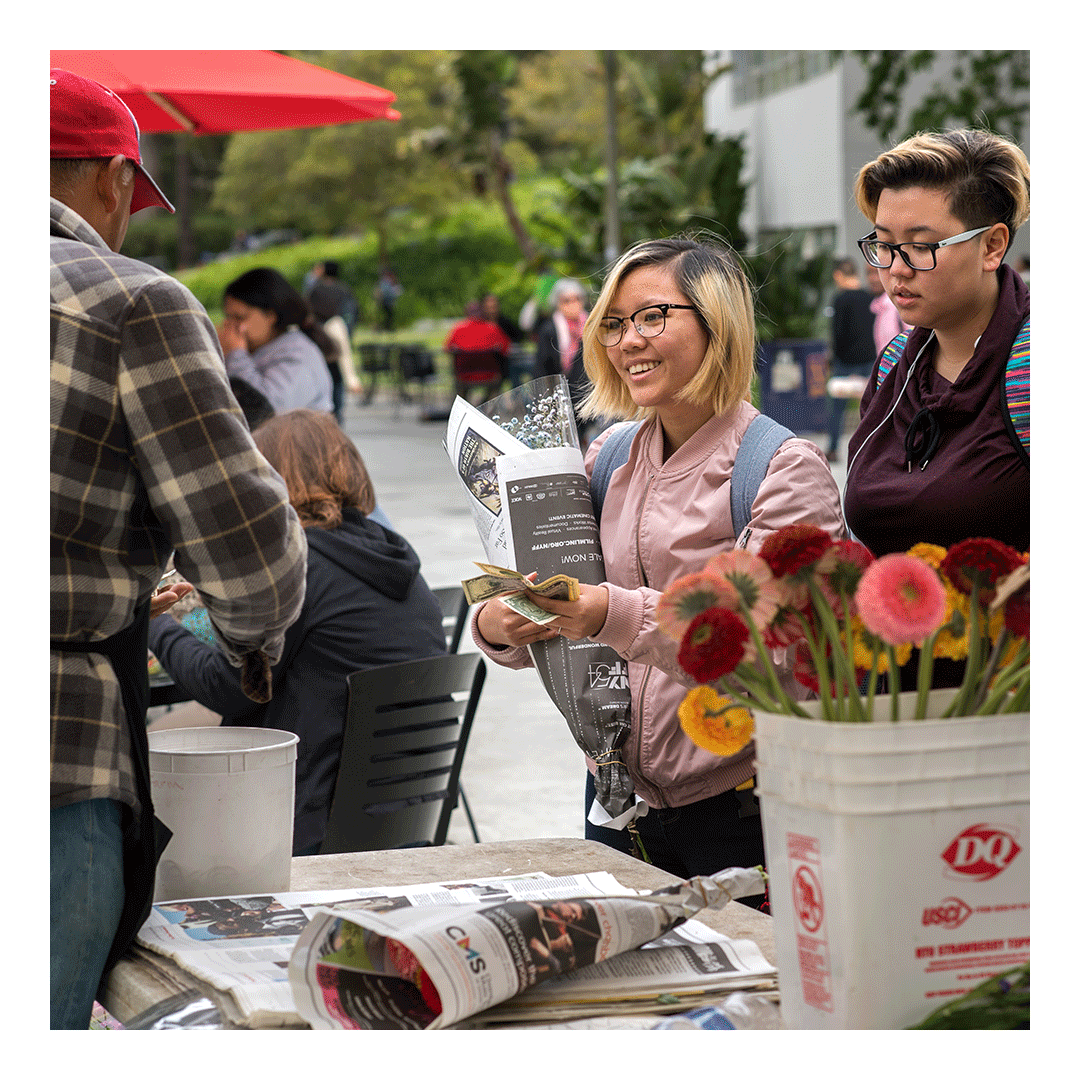 Students buying spring flowers at the Farmers Market at San Francisco State University